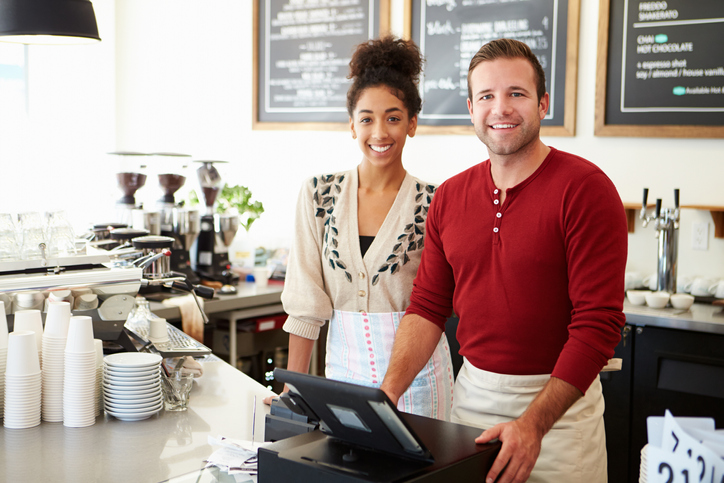 small business owners with epos and card machine